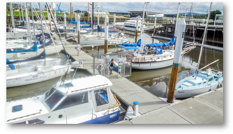 Another of the boat marina... colours of the boats are white with some bright blue, and blue sails