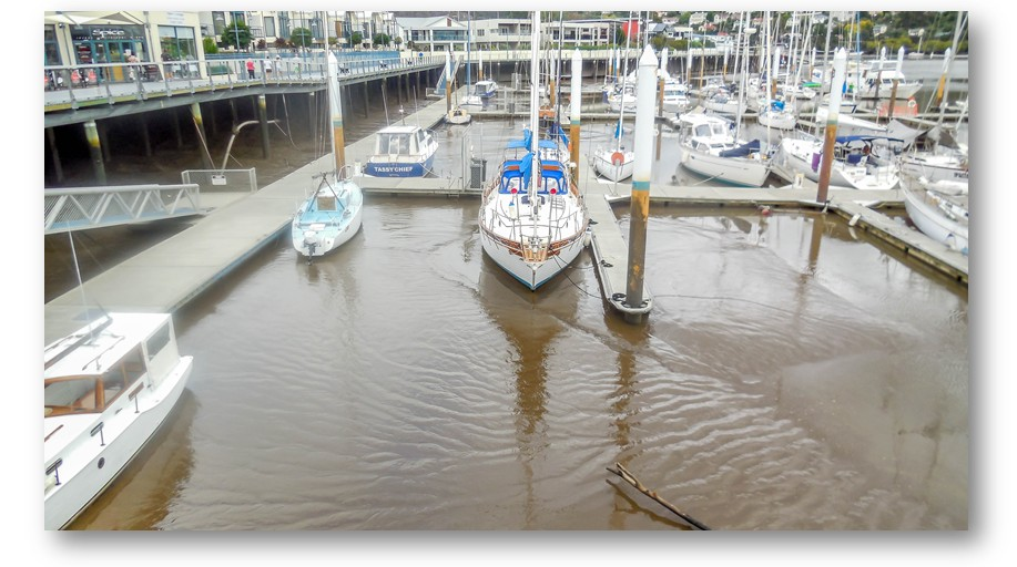 The tide is right out so the boats sit flat on the mud.