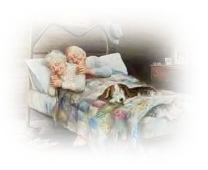Man and woman aged 68 snuggled up in bed